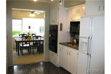 Kitchen is open to the dining room with gas cook top