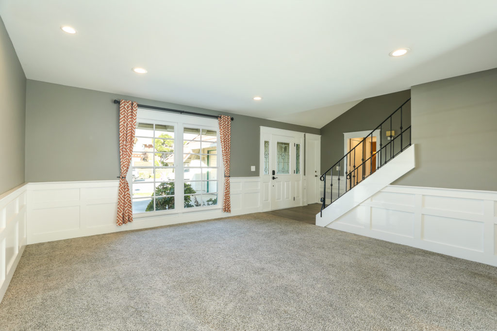 remodeled living room with wainscoting