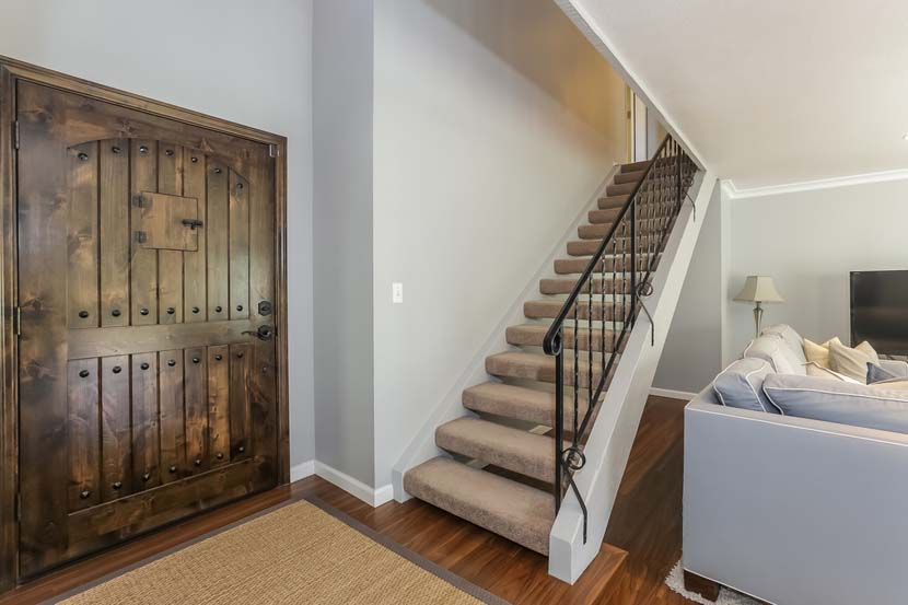 Dual paned windows make for plentiful natural light and new plantation shutters for privacy and a touch of sophistication. The open floor plan downstairs features a large kitchen with formal dining area and clear lines of site to the living room with a wall of windows and slider to the backyard, and a den with a cozy fireplace and yard access.