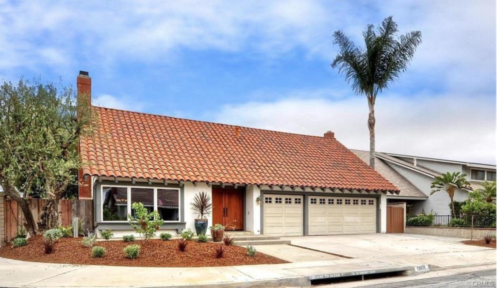 This beautiful property in Huntington Beach has been upgraded, has an open floor plan, and with custom wood windows and doors on both levels it is certainly unique!