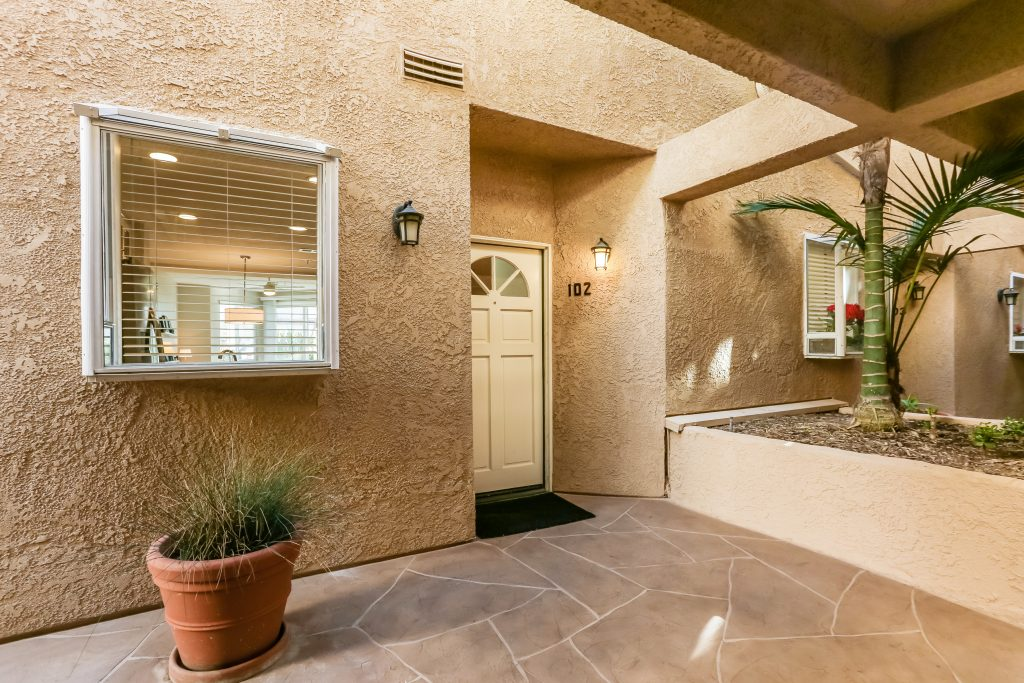 2000 Pacific Coast Highway #102, Huntington Beach is a beautifully remodeled beachfront condo with peak-a-boo ocean views featuring 2 beds / 2 1/2 baths!