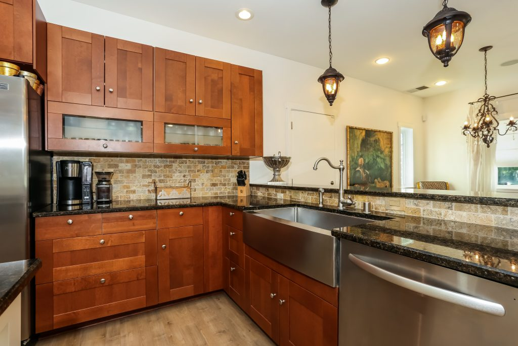 island kitchen with black countertops