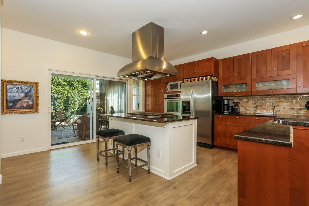 island kitchen with upgraded countertops and cabinets