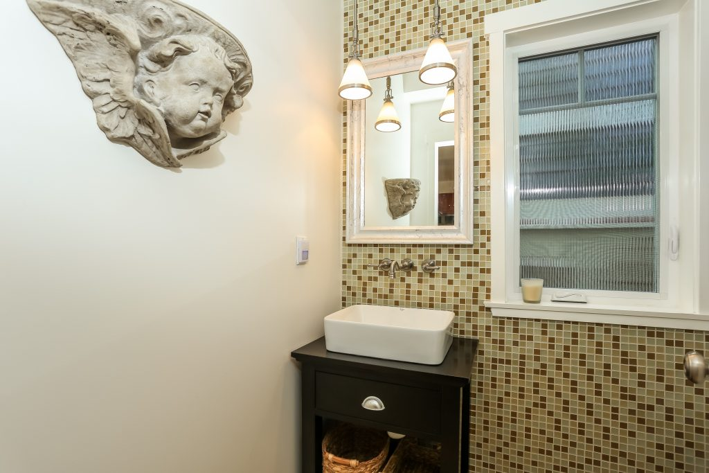 costa mesa bathroom with vessel sink and tile accent all
